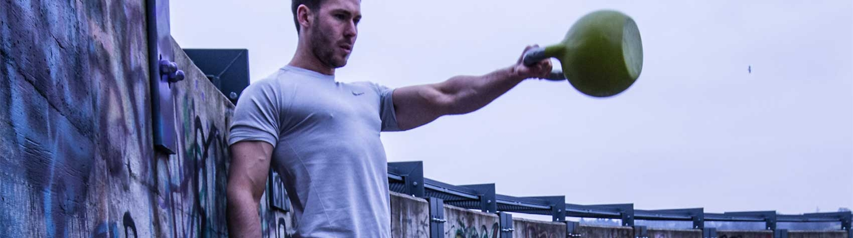 Exerciser swinging a kettlebell