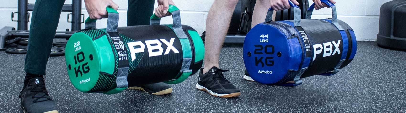 Exercisers holding Power Bags